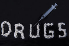 Drugs and syringe Royalty Free Stock Photos