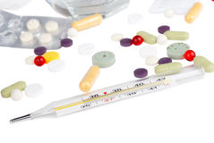 Drugs and thermometer Stock Photography