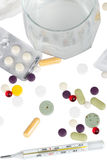 Drugs, thermometer and glass with aspirin Stock Photos