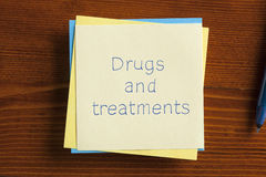 Drugs and treatments written on a note Stock Images