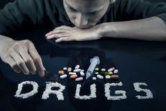 Drugs user preparing drugs to used Royalty Free Stock Image