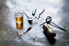 Drugs of various kinds and human skulls on the floor, Collection stock photography