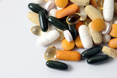 Drugs and vitamins. A view with some drugs and vitamins stock photography