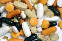 Drugs and vitamins. A view with some drugs and vitamins Royalty Free Stock Photo
