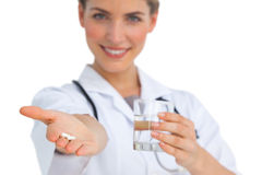 Drugs and water glass held by nurse Stock Image