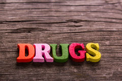 Drugs word made of wooden letters Stock Photos