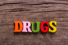 Drugs word made of wooden letters Stock Photo