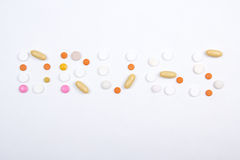 Drugs word text made of colorful tablets Royalty Free Stock Photos
