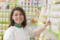 Drugstore. Young female pharmacist in a drugstore royalty free stock images