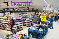 Drugstore department of a Carrefour Hypermarket. MALMEDY, BELGIUM - JULY 2015: Interior, cosmetics and healthcare products in the Beauty section of a Carrefour Royalty Free Stock Photography