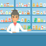 Drugstore pharmacist at the counter. Stock Images