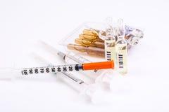 Drugstore Vitamins: round gelatin capsules in a bottle of dark g Royalty Free Stock Photos