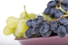 Druiven in een kom Stock Foto's