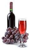 Druiven, glas en fles Royalty-vrije Stock Afbeeldingen