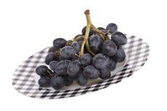 Druiven op een plaat Stock Foto's