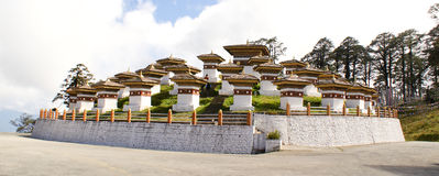 Druk Wangyal Chortens - the 108 chortens at Dochula Pass. Druk Wangyal Chortens, commonly, called as the 108 chortens, is located at Dochula Pass, on the way Stock Image