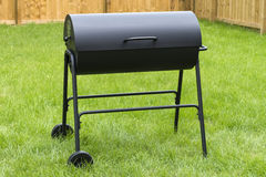 Drum Barrel Charcoal BBQ. Oil barrel style barbecue in garden Stock Photos