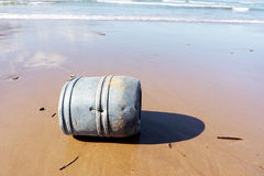 Drum on beach contaminating the sea Stock Photography