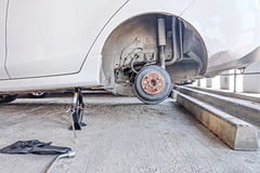 Drum brake assembly, changing tire. Stock Images