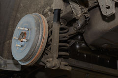 Drum brake of a car. Closeup of a brake drum of vehicle on the lifting platform Stock Images