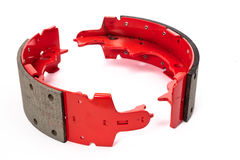Drum brake shoes. Auto spare parts - red drum brake shoes Stock Photography