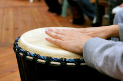 Drum circle woman hands. Close up of woman's hands as she drums in a drum circle Royalty Free Stock Photography