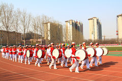 Drum corps marching on the playground Royalty Free Stock Photos
