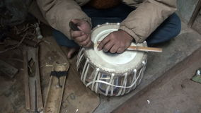 Drum craftsman working with tabla drum in Varanasi, India Royalty Free Stock Image