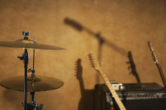 Drum Cymbals and Guitars by Amplifier Stock Photography