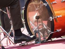 Drum drummer pedal. Drummer`s foot is on the pedal and beats the drum stock photos