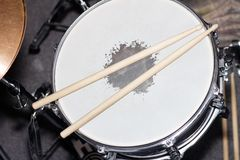 Drum with drumsticks as a musical background. Closeup image Royalty Free Stock Photography