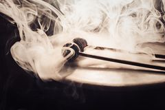 Drum and drumsticks. Sticks with balls lie on the drum. in the smoke Stock Photos