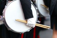 Drum with a hand and drumsticks on parade Stock Image