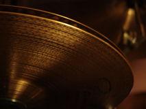 Drum Highhat Cymbal. View from under the drum set of a partially oppened high-hat Stock Photos