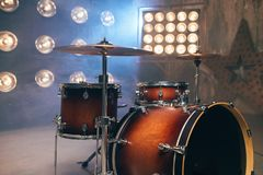 Drum-kit, drum-set, percussion instrument, drumkit. On the stage with lights, nobody. Drummer professional equipment, beat set royalty free stock image