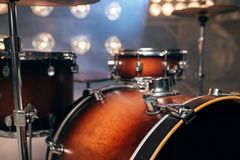 Drum-kit, drum-set, percussion instrument, nobody. Drum-kit, drum-set, percussion instrument on the stage with lights, nobody. Drummer professional equipment royalty free stock photos