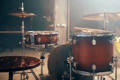 Drum-kit, drum-set, percussion instrument, nobody. Drum-kit, drum-set, percussion instrument on the stage with lights, nobody. Drummer professional equipment royalty free stock photography