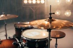 Drum kit, percussion instrument, beat set, nobody. Drum kit, percussion instrument on the stage with lights, nobody. Drummer professional equipment, beat set Stock Photos