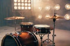 Drum kit, percussion instrument, beat set, nobody. Drum kit, percussion instrument on the stage with lights, nobody. Drummer professional equipment, beat set stock images