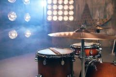 Drum kit, percussion instrument, beat set, nobody. Drum kit, percussion instrument on the stage with lights, nobody. Drummer professional equipment, beat set stock image