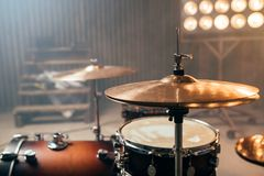 Drum-kit, drum-set, percussion instrument, drumkit. On the stage with lights, nobody. Drummer professional equipment, beat set stock photo
