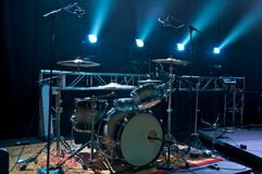 Drum Kit on Stage. Backlit with stage lighting Stock Images
