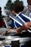Drum Line. Line of drummers playing in a high school marching band royalty free stock photography