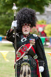 Drum Major Leads Pipe And Drums Unit At Spring Festival Stock Photo