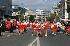 Drum majorettes marching along a street royalty free stock photo