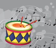 A drum with musical notes Stock Image