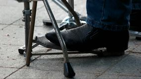 Drum pedal and feet. Close up. Percussion instrument, bass drum with pedal stock video footage