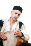 Drum player. Iranian man playing a traditional drum Stock Photography