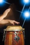 Drum player. Palynig the drum with the hands Royalty Free Stock Images