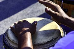 Drum player playing atabaque. During presentation of afro music on the eve of the Brazilian carnival Stock Photo